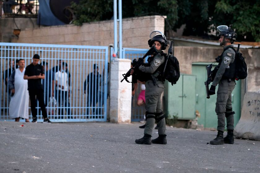 Israeli border guards stand at attention in the east Jerusalem neighborhood of Sheikh Jarrah.