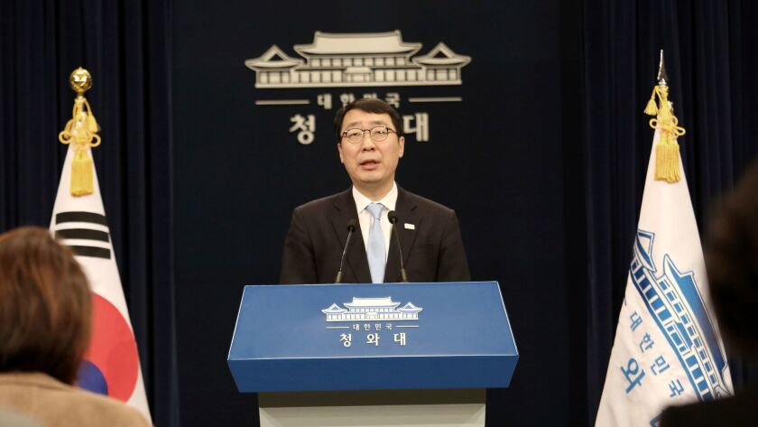 Yoon Young-chan, South Korean President Moon Jae-in's press secretary, briefs reporters on March 4, 2018, about plans to send a 10-member delegation to North Korea this week to discuss peace on the Korean peninsula.