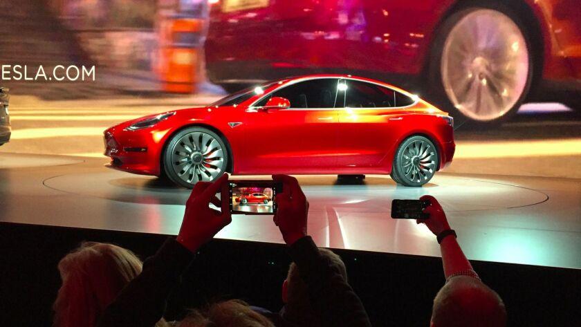 Tesla Motors unveils the new lower-priced Model 3 sedan at the Tesla Motors design studio in Hawthor
