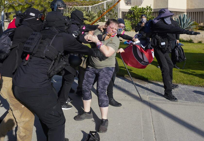 Antifa members and Black Lives Matter supporters clash with pro-Trump marchers in Pacific Beach.