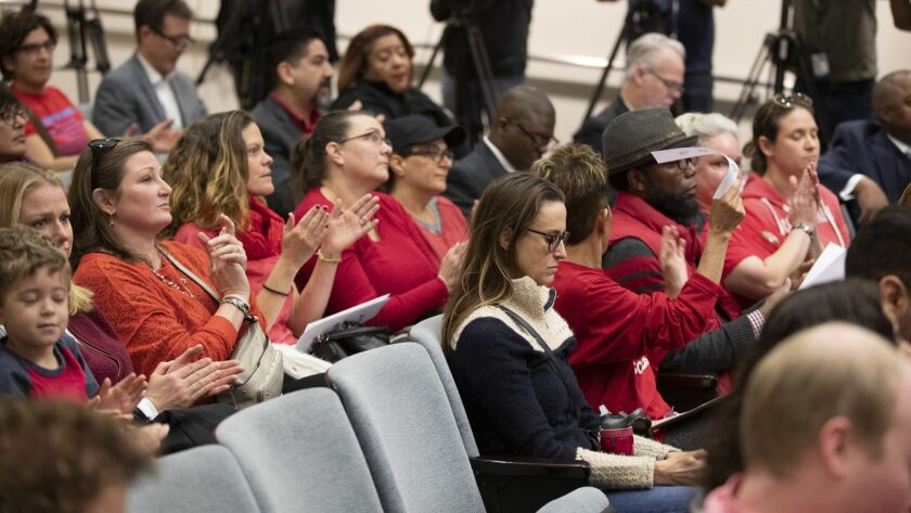 A group of teachers supporters applaud a fellow supporter speaking during a Los Angeles Unified School District Board of Education meeting in Los Angeles on Jan. 8.
