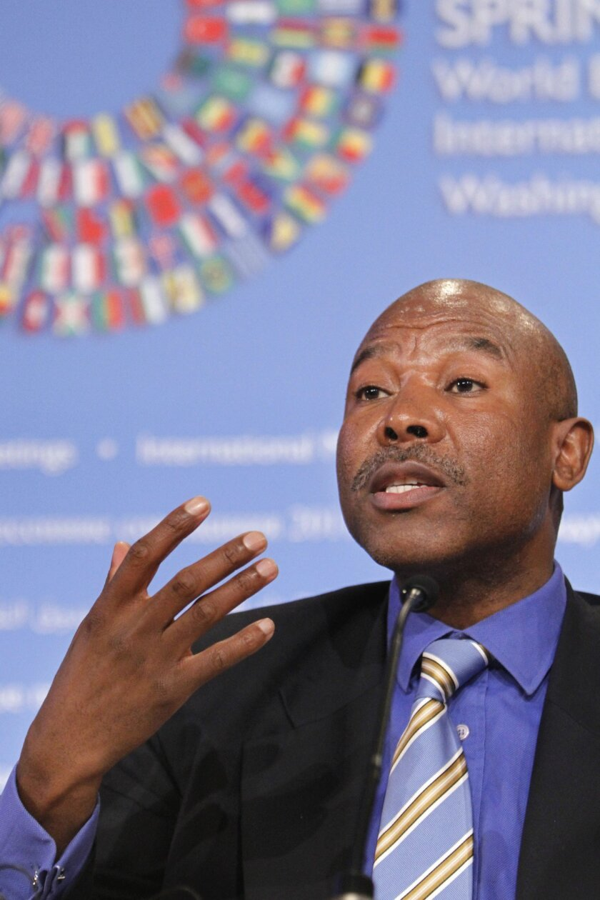 FILE - This file photo taken Thursday, April 14, 2011 of Lesetja Kganyago, Director General of South Africa's National Treasury, as he gestures during a news conference to discuss the G-24 meeting at the 2011 Spring Meetings of the World Bank/IMF in Washington. Kganyago has been appointed as the country's new reserve bank governor to replace Gill Marcus, who is retiring next month. (AP Photo/Jacquelyn Martin-File)