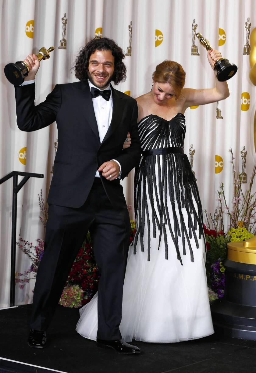 """Sean Fine and Andrea Nix Fine pose after winning Best Documentary Short Subject for their film """"Inocente"""" at the 85th Academy Awards in Hollywood"""