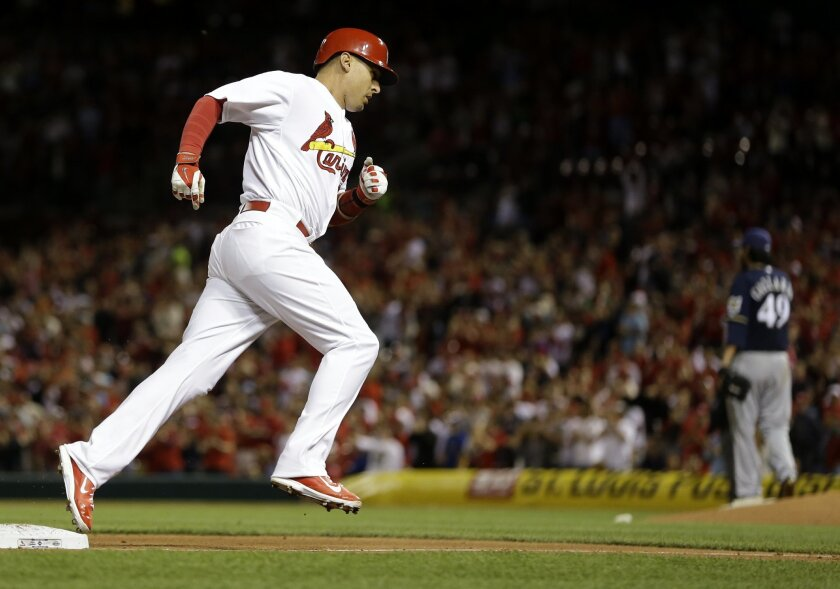 St. Louis Cardinals' Allen Craig rounds the bases after hitting a solo home run off Milwaukee Brewers starting pitcher Yovani Gallardo during the sixth inning of a baseball game Monday, April 28, 2014, in St. Louis. (AP Photo/Jeff Roberson)