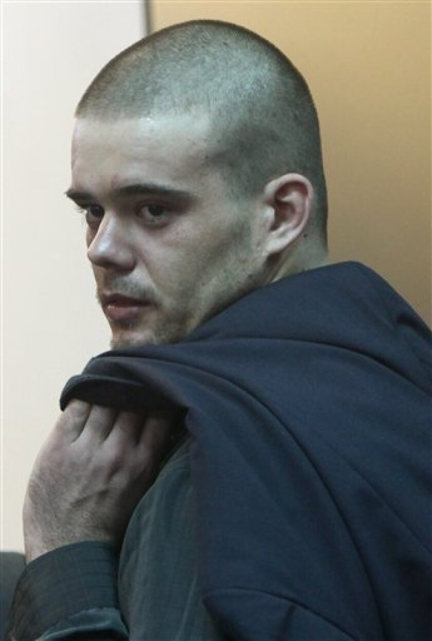 Joran Van der Sloot looks over his shoulder as he leaves the courtroom after his murder trial was postponed at the San Jorge prison in Lima, Peru, Friday, Jan. 6, 2012. Dutch citizen Joran van der Sloot asked for more time Friday to decide how to plead in his trial for the 2010 murder of a 21-year-old Peruvian woman. His case was postponed until Jan. 11. (AP Photo/Karel Navarro)