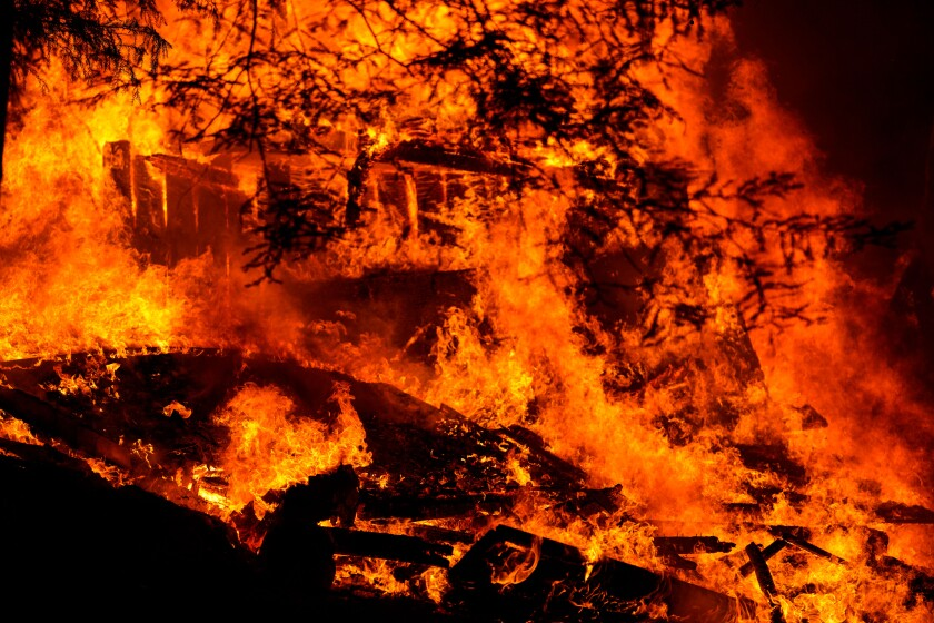 A house is engulfed in flames