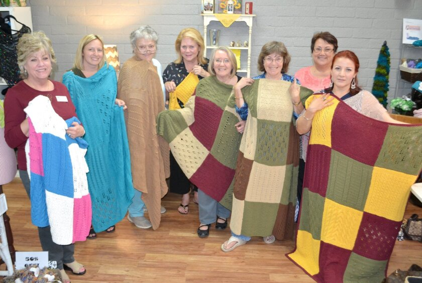 Blocks knitting class are, from left: store owner Connie Phillips, Kira Reynolds, Carolyn Elias, Marilyn Webber, Stephanie Hurst, Lynne Shevinsky, June Ford and Ebed Almaraz.