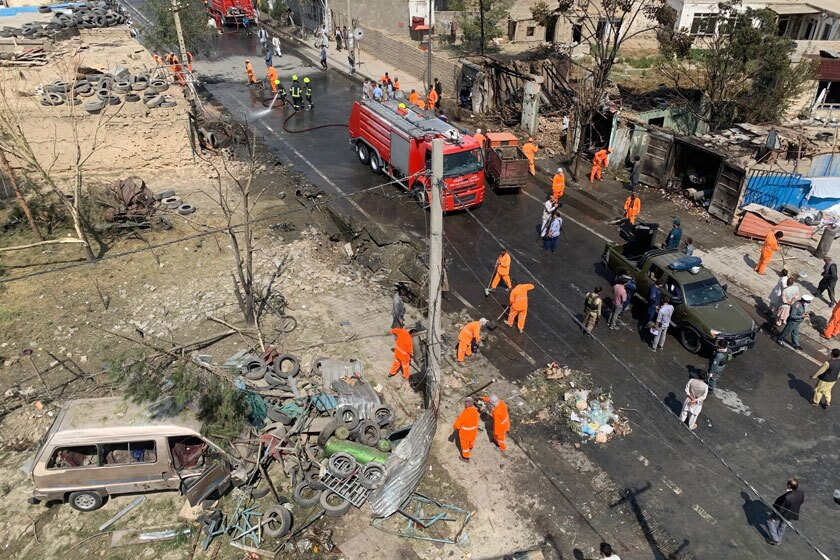Workers clean the site of an explosion in Kabul, Afghanistan, on Wednesday.