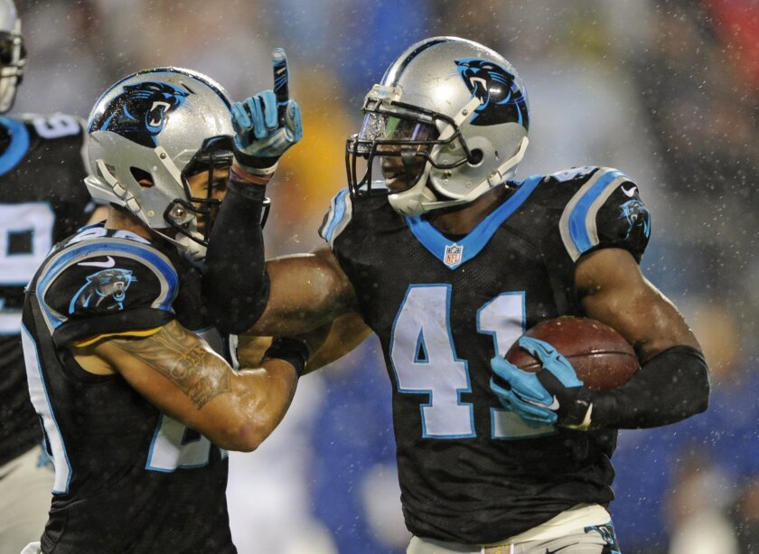 Carolina Panthers' Roman Harper, right, celebrates his fumble recovery against the Indianapolis Colts with teammate Kurt Coleman, left, in the first half of an NFL football game in Charlotte, N.C., Monday, Nov. 2, 2015. (AP Photo/Mike McCarn)