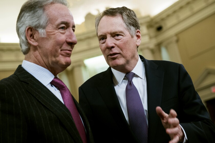 U.S. Trade Representative Robert E. Lighthizer, right, and House Ways and Means Chairman Richard Neal talk in February. Efforts are under way to wrap up negotiations on the replacement for NAFTA.