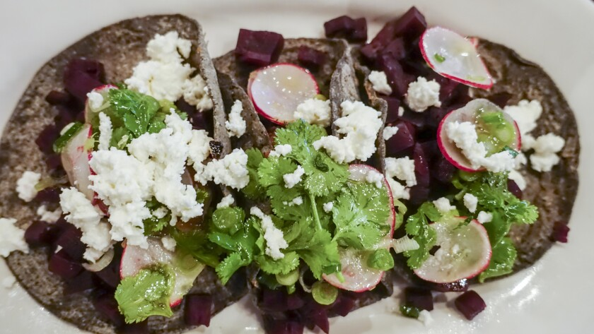 Verde y Crema serves tacos made with local organic beets, cheese and homemade blue-corn tortillas.