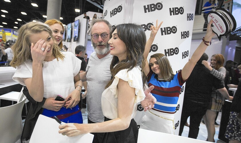 """""""Game of Thrones"""" cast members Natalie Dormer, from left, Sophie Turner, Liam Cunningham and Carice van Houten get photobombed by Maisie Williams, far right, at San Diego Comic-Con."""