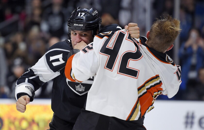 Kings left wing Milan Lucic (17) fights with Ducks defenseman Josh Manson (42) during the second period of a preseason game Sept. 29, 2015.