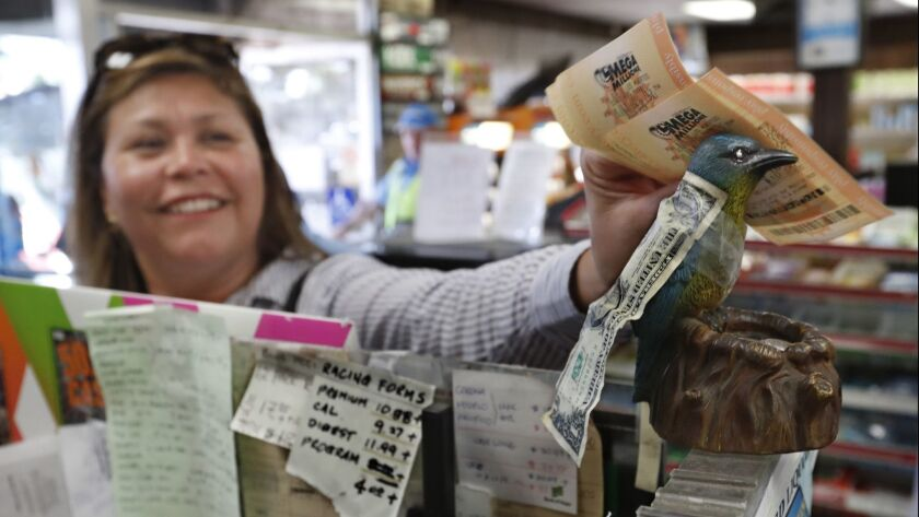 HAWTHORNE, CA-OCTOBER 19, 2018: Juana Soto, of Inglewood, rubs her mega-millions lottery tickets a