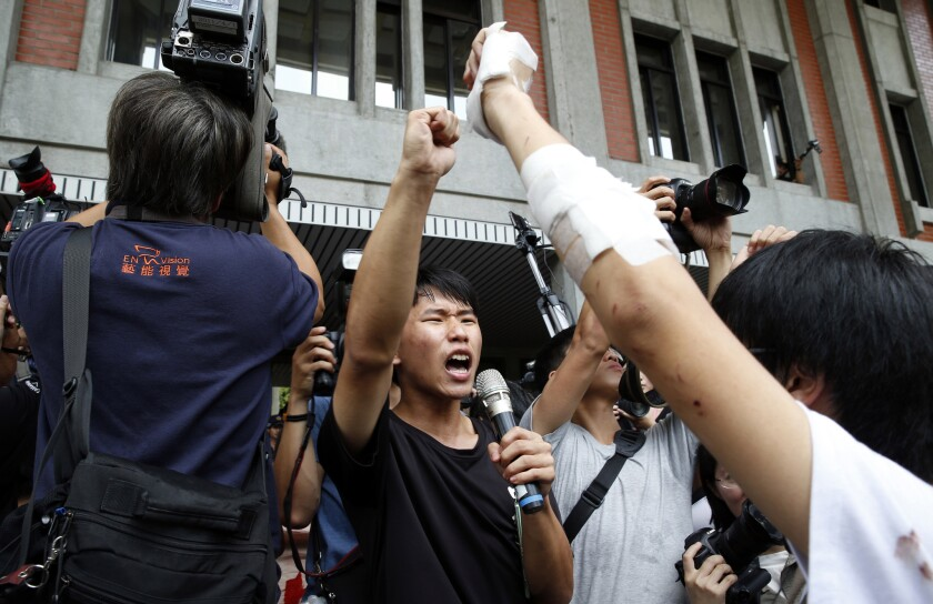 Student protesters occupy the area inside the gates of the Ministry of Education in Taipei, Taiwan, on July 31.