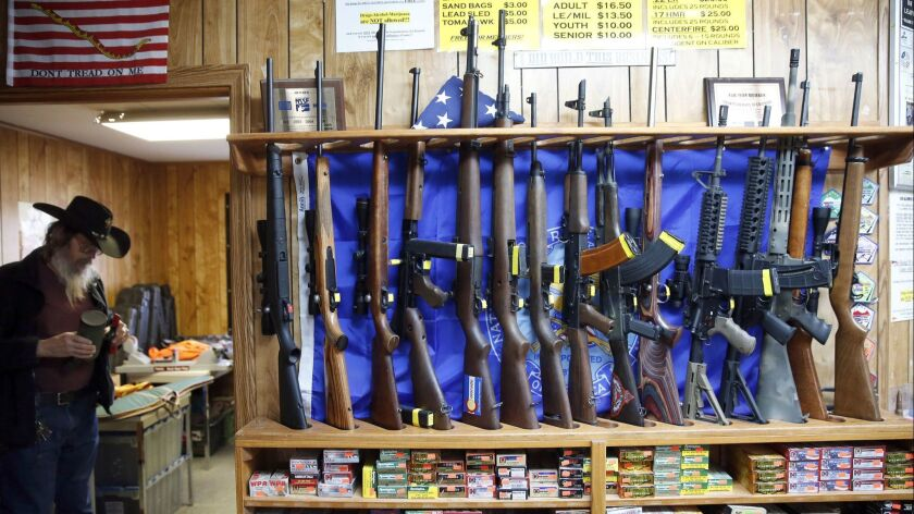 In this March 15, 2016 photo, guns for rent are on display at a shooting range and retail store in C