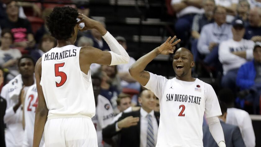 San Diego State's Jalen McDaniels (5) celebrates with teammate Adam Seiko (2) after sinking a 3-poin