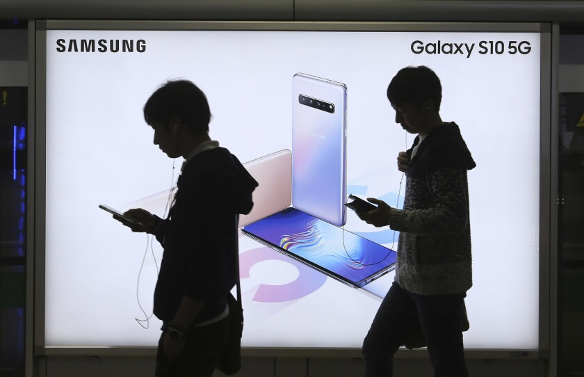 People pass by an advertisement of Samsung Electronics' Galaxy S10 5G smartphone at a subway station in Seoul last year.