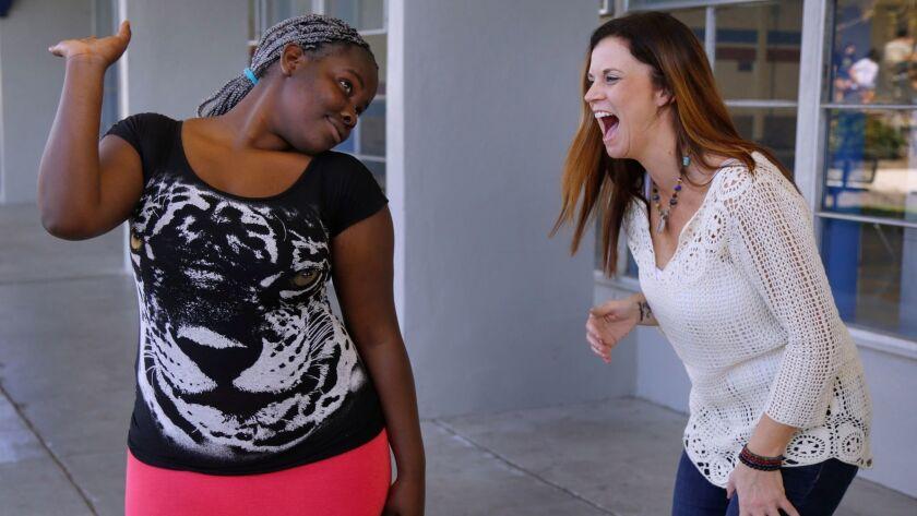 Divine Ngabire (left) with singer-songwriter Kathryn Cloward.
