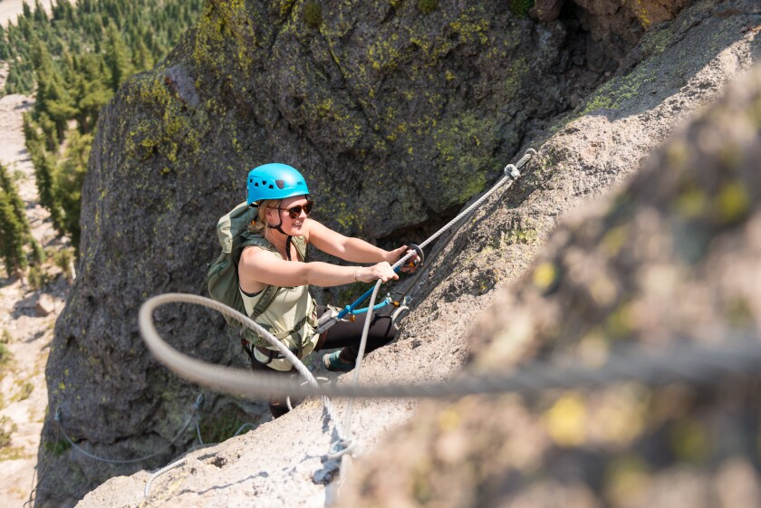 A woman climbs a rockface at Mammoth Mountain's Adventure Center.