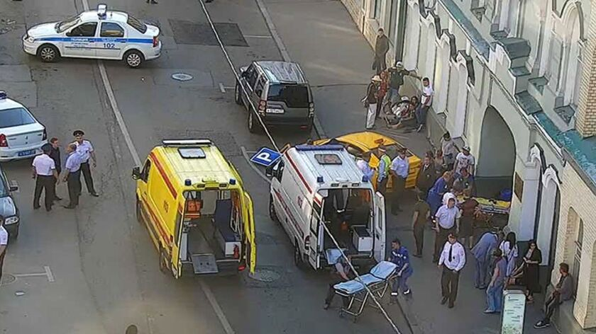 In this image provided by Moscow Traffic Control Center Press Service, ambulance and police work at