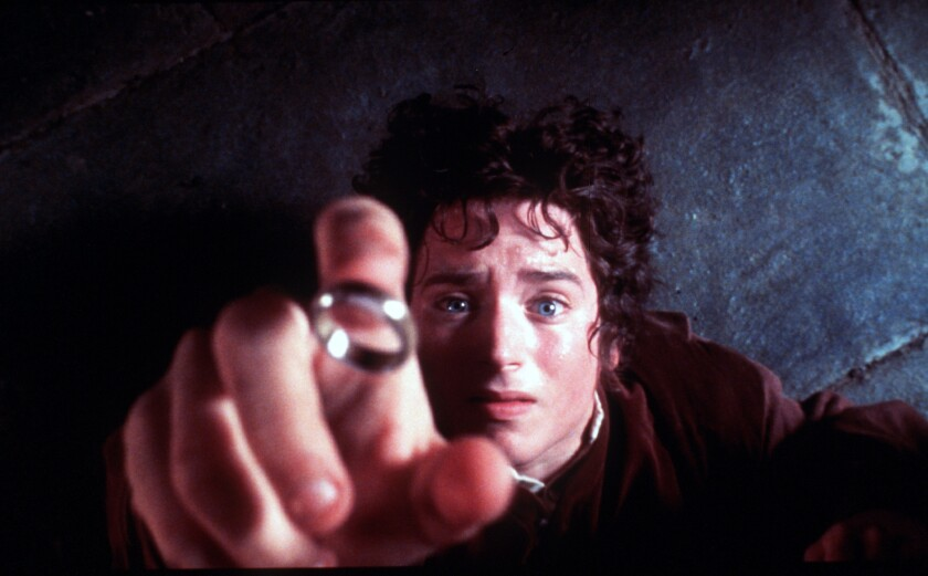 """Frodo (Elijah Wood) reaching for the One Ring in a scene from a """"Lord of the Rings"""" film."""