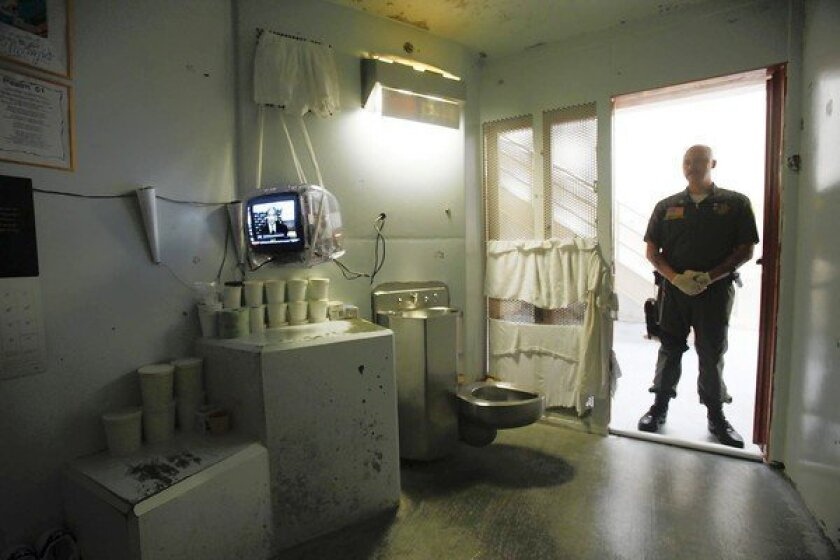 A guard stands in the doorway of a cell at the Secure Housing Unit at Pelican Bay State Prison in Crescent City, Calif. The long-running hunger strike was directed at incarceration of inmates in such units.