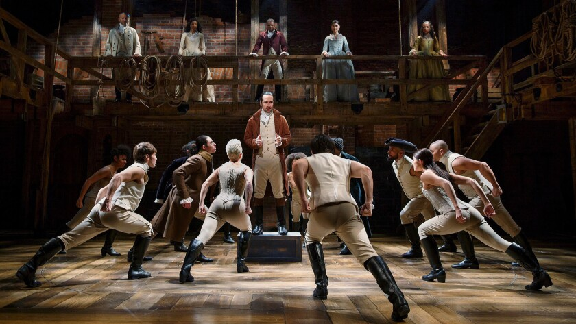 """Lin-Manuel Miranda, center, and the company of """"Hamilton"""" perform at the Public Theater in New York last year."""