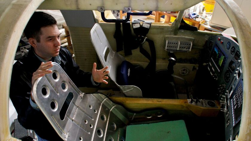 Xcor Aerospace spokesman Mike Massee shows off the full-sized model of a Lynx cockpit in 2007. Last
