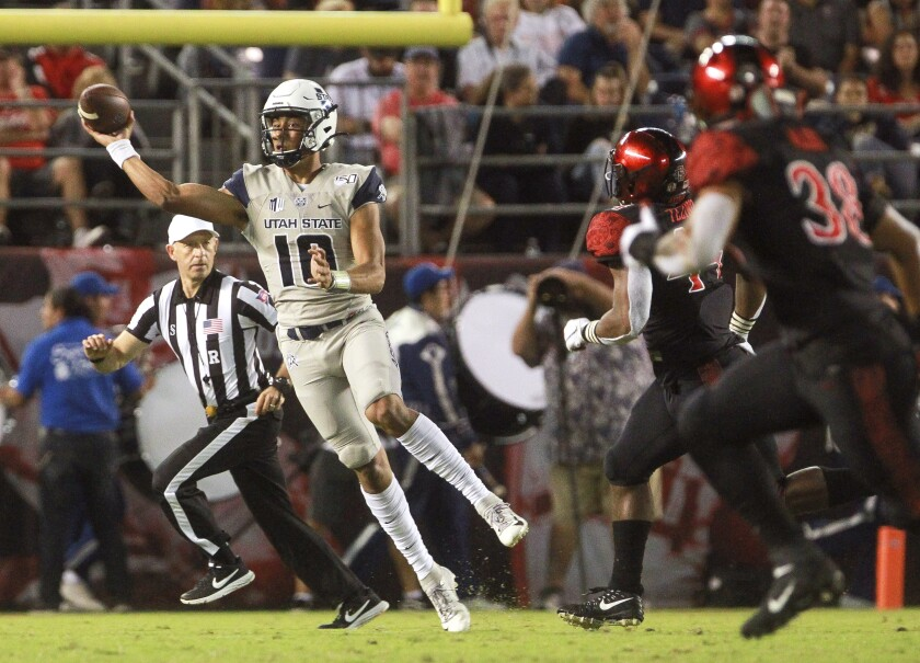 Utah State quarterback Jordan Love throws a pass during the first quarter in Saturday night's Mountain West game against the San Diego State at SDCCU Stadium.