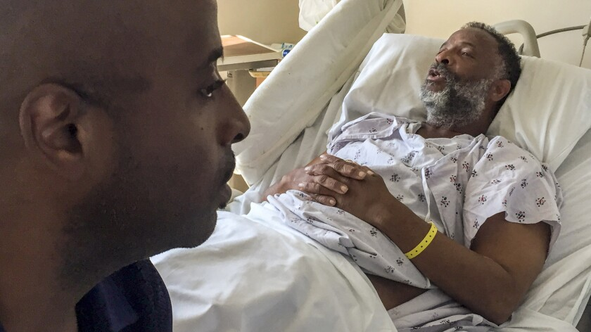 Marlon Saville visits his homeless father, George Saville, in USC hospital in Los Angeles.