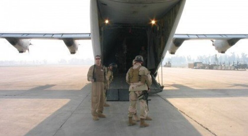 Technical Sgt. Stephen C. Mellan, left, in Mosul, Iraq. Courtesy of the U.S. Air Force