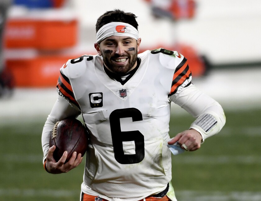 FILE - In this Jan. 10, 2021, file photo, Cleveland Browns quarterback Baker Mayfield runs off the field after defeating the Pittsburgh Steelers in an NFL wild-card playoff football game in Pittsburgh. Mayfield's offseason included running, lifting, getting a guaranteed $18 million and a celestial close encounter he will not forget. On his way home from dinner in Texas last month with his wife, Emily, Mayfield said he saw a UFO. (AP Photo/Justin Berl, File)