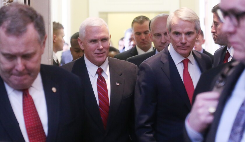 Sen. Rob Portman (R-Ohio), right, with Vice President Mike Pence at a Republican policy lunch.
