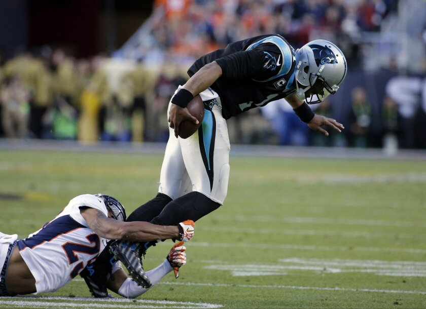 Carolina Panthers' Cam Newton (1) is tackled by Denver Broncos' Chris Harris Jr. (25) during the first half of the NFL Super Bowl 50 football game Sunday, Feb. 7, 2016, in Santa Clara, Calif. (AP Photo/Matt York)