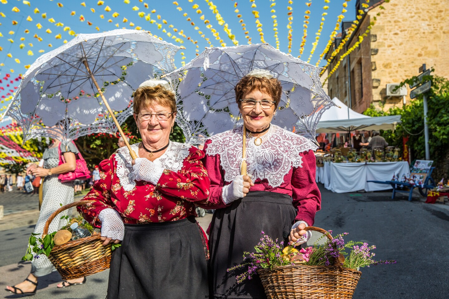 DORDOGNE, FRANCE - Lace is an important element of authentic Occitan costumesÑusually handmade by the participantsÑat La FŽlibrŽe which is held in a different town in Dordogne each July.
