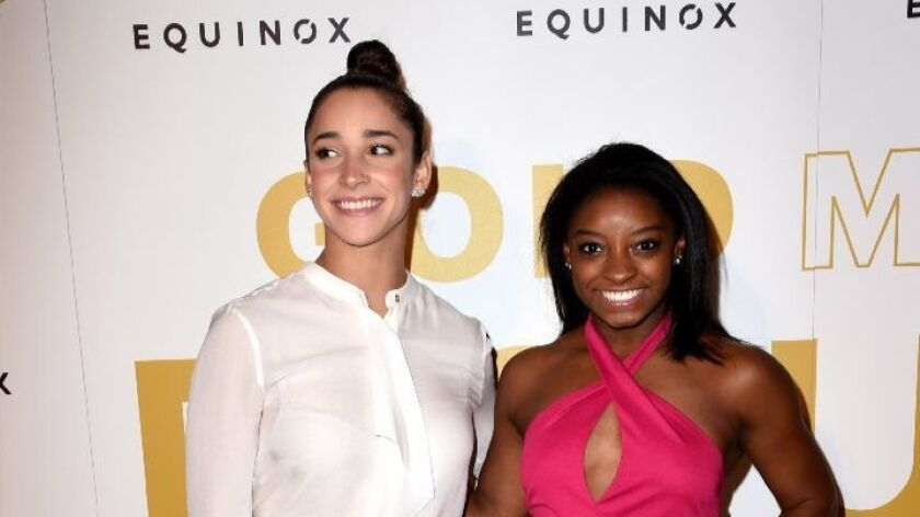 Olympic athletes Aly Raisman, left, and Simone Biles are part of the Gold Meets Golden festivities in West L.A.