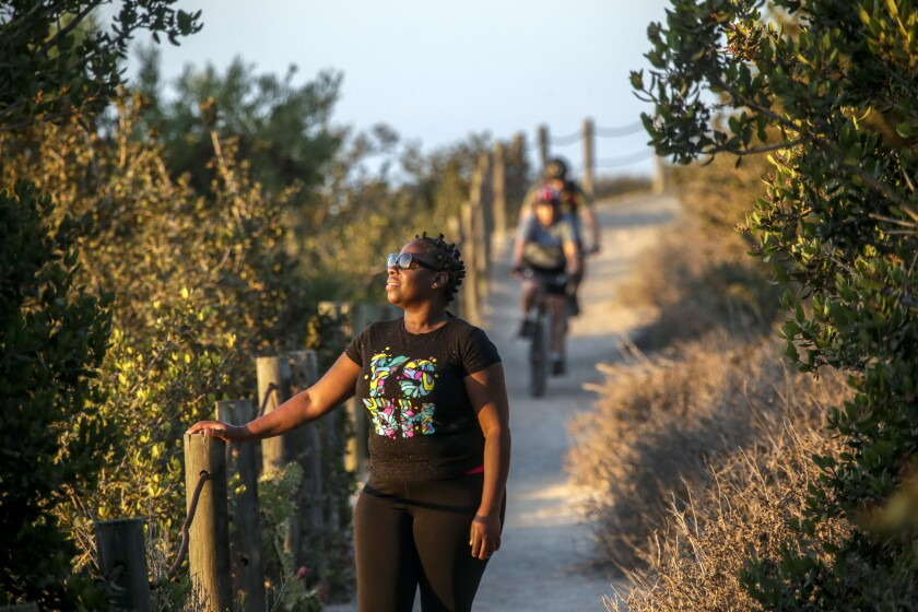 Nadine Jackson, 46, hikes on El Portal Trail in Rancho Palos Verdes. A recent survey suggests that more minorities are spending time in the outdoors.