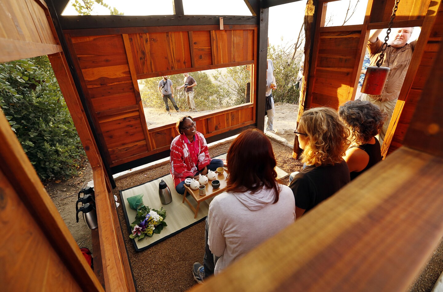 Williams, left, pours tea for Stacey Abarbanel, Karin Huebner and Michele Raitano, seated left to right. The teahouse was designed with the aid of experienced woodworkers and bolted to an abandoned foundation inside Griffith Park.