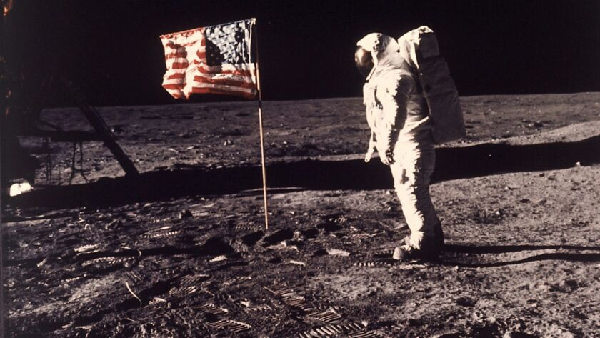 FILE - In this image provided by NASA, astronaut Buzz Aldrin poses for a photograph beside the U.S.
