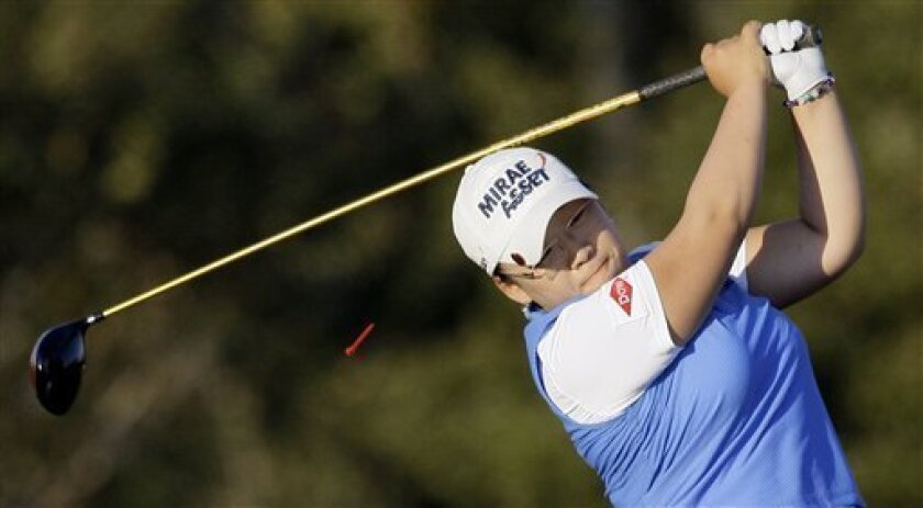 Jiyai Shin, of South Korea, hits her tee shot on the 13th hole during the second round of the LPGA Tour Championship golf tournament Sunday, Nov. 22, 2009, in Richmond, Texas. Weather delays over the previous two days shortened the tournament to 54 holes which officials hope to finish on Monday. (AP Photo/David J. Phillip)