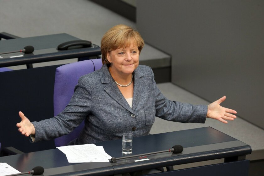 German Chancellor Angela Merkel gestures as she attends a debate at the German parliament prior to a vote on another bailout package for Greece, in the German Bundestag in Berlin, Wednesday, Aug. 19, 2015. (Wolfgang Kumm/dpa via AP)