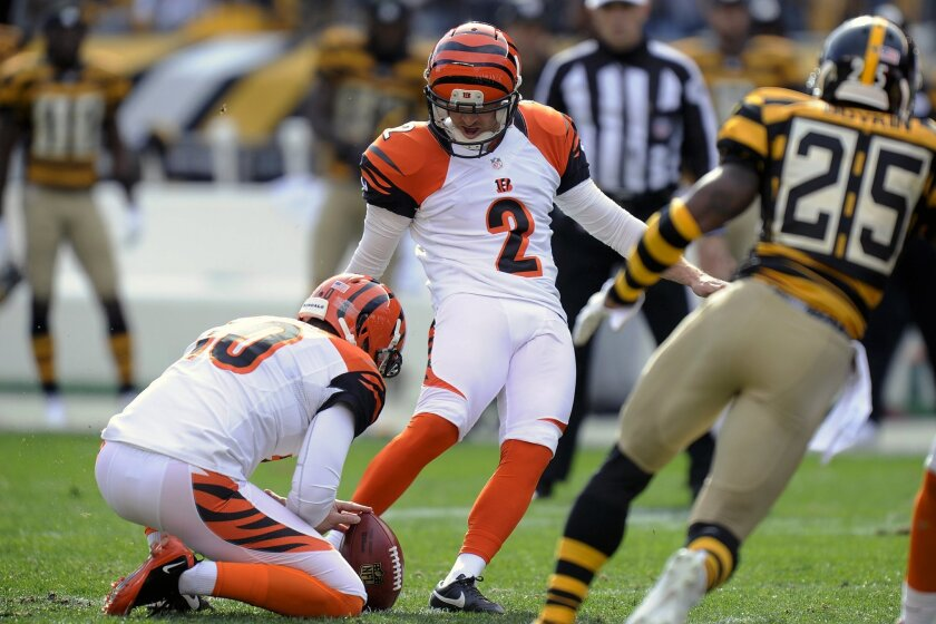 Cincinnati Bengals kicker Mike Nugent (2) makes a field goal as Pittsburgh Steelers defensive back Brandon Boykin (25) rushes in the first quarter of an NFL football game, Sunday, Nov. 1, 2015 in Pittsburgh. (AP Photo/Don Wright)