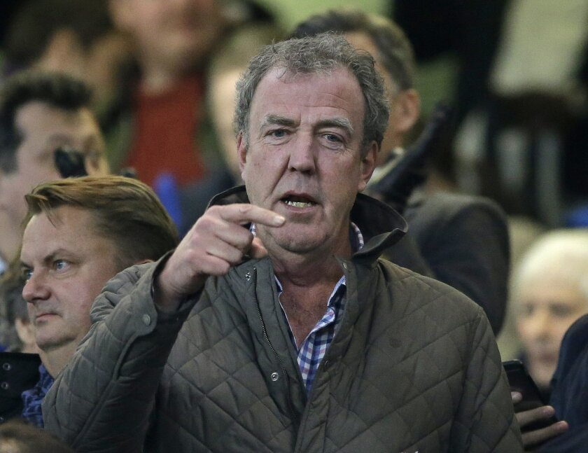 """Top Gear"" host Jeremy Clarkson gestures as he takes his place in the stands before the Champions League round of 16 second leg soccer match between Chelsea and Paris Saint Germain at Stamford Bridge stadium in London, Wednesday, March 11, 2015. Clarkson has been suspended by the BBC."