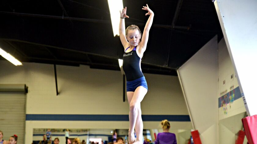 Natalie Siljander, 8, of Encinitas goes through a beam routine at Magdalena Ecke Family YMCA on Jan. 19 that earned her a perfect 10 at a recent gymnastics competition in Arizona.