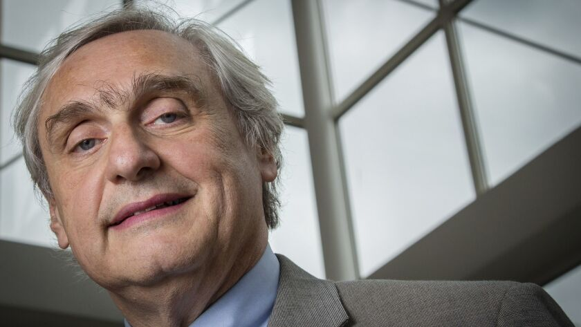 In this July 24, 2014, file photo, then-Chief Judge of the U.S. Court of Appeals for the 9th Circuit Alex Kozinski poses for a portrait in the lobby of a Washington office building.