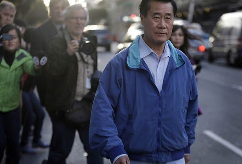 California Sen. Leland Yee, D-San Francisco, right, leaves the San Francisco Federal Building, Wednesday, March 26, 2014, in San Francisco. The FBI has filed a 137-page affidavit outlining a detailed corruption case against Yee, who is accused of asking for campaign donations in exchange for introd