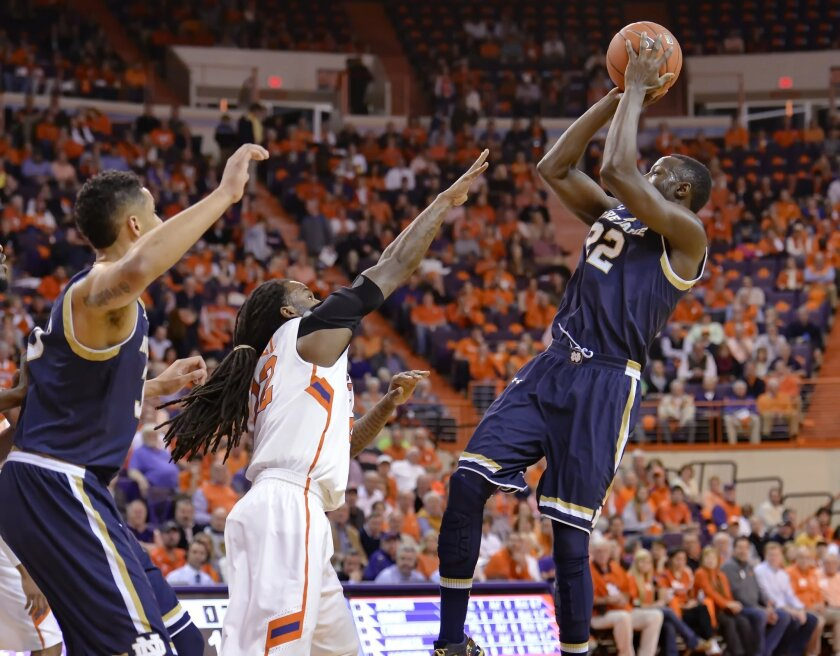 FILE - In this Feb. 10, 2015, file photo, Notre Dame's Jerian Grant leans back for a 3-point shot while defended by Clemson's Rod Hall during an NCAA college basketball game in Clemson, S.C. Many college teams, including Iowa State, Indiana and Notre Dame, are increasingly passing up mid-range jumpers, looking for space and uncontested shots _ which these days are found closer to the rim or beyond the 3-point line. (AP Photo/Richard Shiro, File)