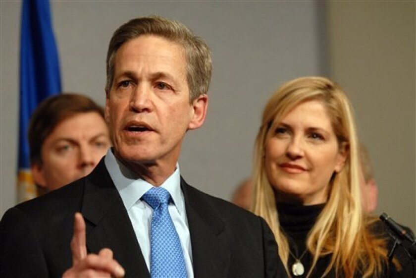 Republican Norm Coleman along with his wife Laurie and several supporters announces he is suing to challenge the results of the U.S. Senate recount during a press conference Tuesday Jan. 6, 2009 at the State Office Building in St. Paul, Minn.  Coleman lost the recount to Democratic  candidate Al Fr