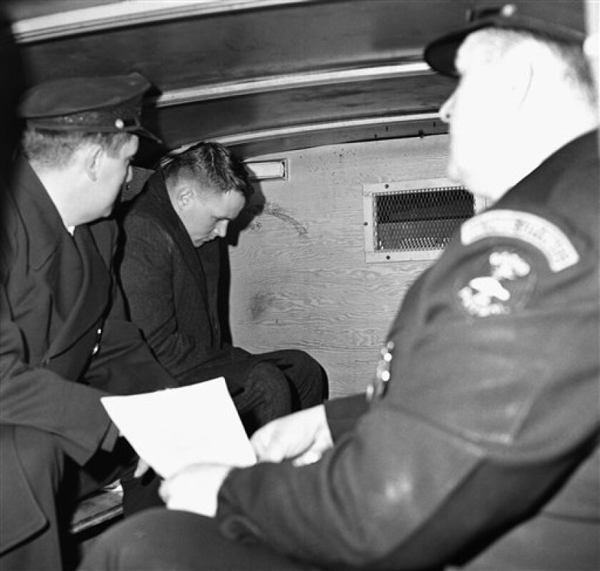 In this  Feb. 11, 1963 file photo,  William Zantzinger, 24, center, of Mount Victoria, Md., is taken to city jail by two unidentified Baltimore policemen after he was ordered held without bail on homicide charges in Baltimore, Md. Zantzinger, a wealthy Maryland landowner whose fatal beating of a
